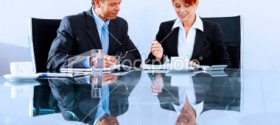 istockphoto_9278090-mature-business-colleagues-working-in-a-modern-office